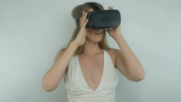 Thumbnail for Sexy Girl In A Virtual Reality Helmet Uses The App
