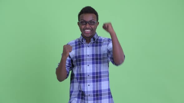Thumbnail for Happy Young African Hipster Man Getting Good News