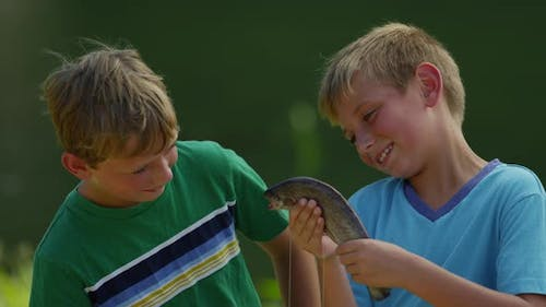 Boys playing with fish
