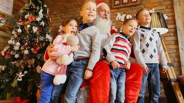 Thumbnail for Three Brothers and Sister Visiting Santa.