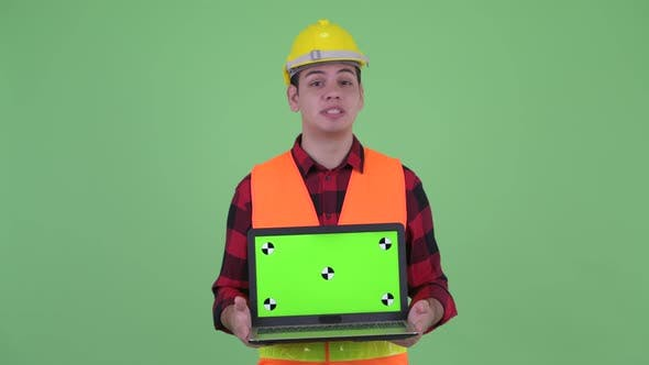 Thumbnail for Happy Young Multi Ethnic Man Construction Worker Talking While Showing Laptop