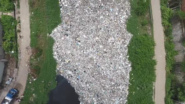 Thumbnail for Aerial view of trash floating on a river, Cambodia.