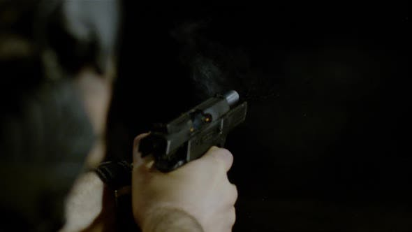 Thumbnail for Pistol shooting a bullet, Ultra Slow Motion