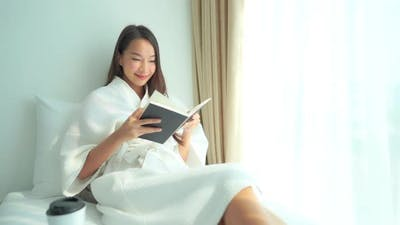 Young asian woman read book