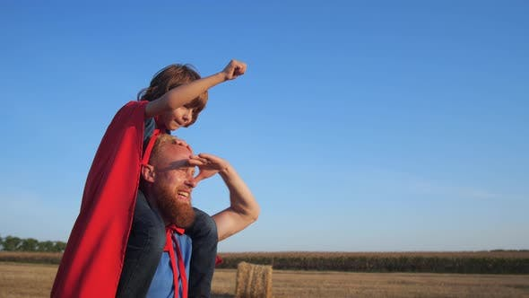 Thumbnail for Dad Walking with Son on His Shoulders Across Field