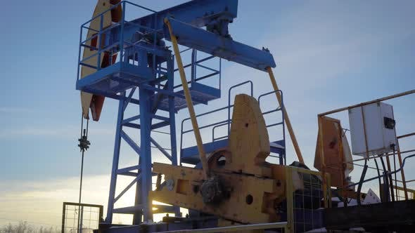 Thumbnail for Pumpjack on an Oil Well in Winter Forest in Daytime