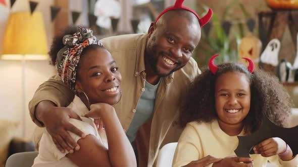 Thumbnail for Portrait of Joyous Afro-American Family Preparing for Halloween