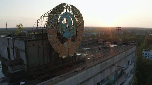 Drone Shot of Emblem on Building's Roof in Pripyat
