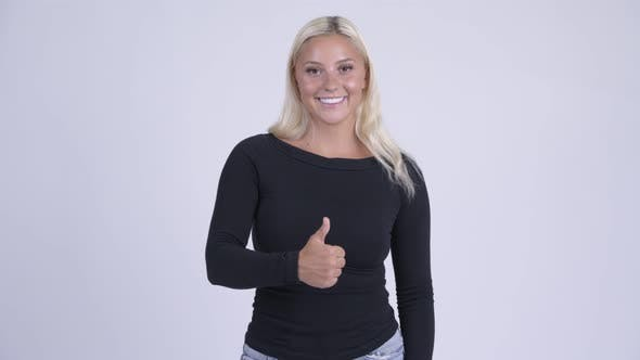 Thumbnail for Young Happy Blonde Woman Giving Thumbs Up