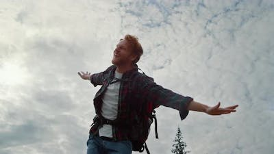 Male Hiker Raising Hands in Air