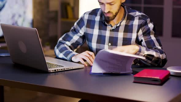 Thumbnail for Young Entrepreneur Working on Laptop and Signing Documents
