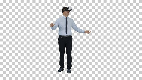 Astonished young businessman wearing VR glasses Concept of the