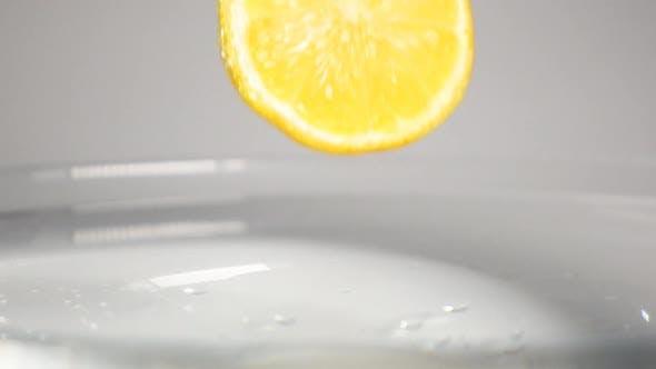 Thumbnail for Half Lemon Drip Into Water