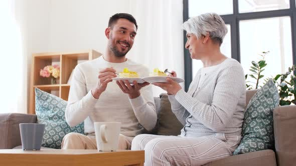 Cover Image for Senior Mother and Adult Son Eating Cake at Home