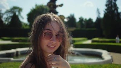Brunette Woman in Park in Summer