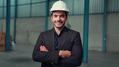 Portrait Confident Factory Manager Wearing Suit and Safety Helmet