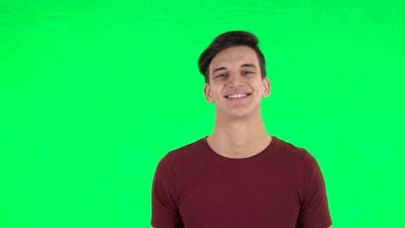 Thumbnail for Guy Smiling While Looking at Camera and Flirting. Green Screen