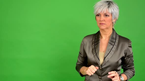 Thumbnail for Business Middle Aged Woman Speaks (Talking) - Green Screen - Studio