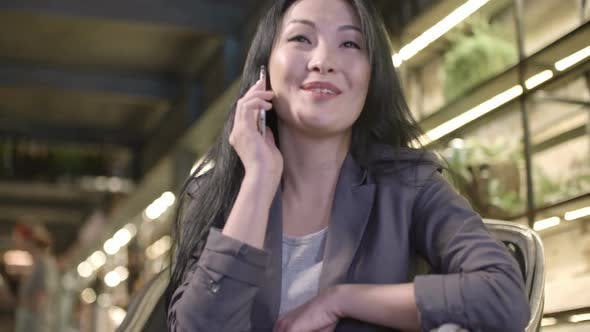 Thumbnail for Beautiful Asian Woman Chatting on Mobile Phone