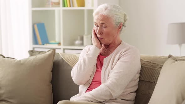 Thumbnail for Senior Woman Suffering From Toothache at Home