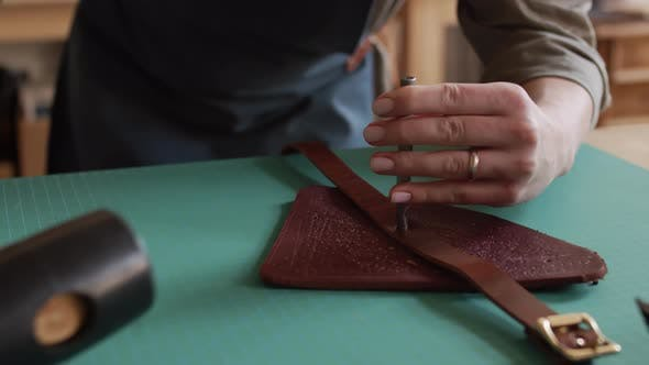 Currier Making Hole in Handmade Leather Belt