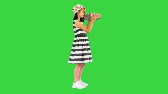 Holidays Presents Christmas Xmas Birthday Concept Happy Child Girl with Gift Box on a Green Screen