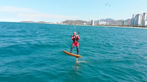 Extreme Water Sport and Summer Vacations Concept. Professional Kite Surfer on the Sea Wave, Athlete