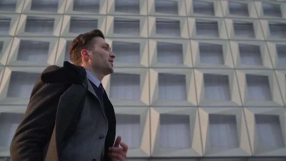 Thumbnail for Man in suit running