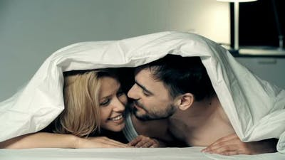 Playful Lovers in Bed