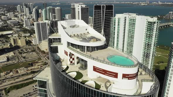Aerial video rooftop swimming pool luxury highrise Downtown Miami FL