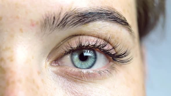 Thumbnail for Eye of the girl close-up, woman opening her blue eye