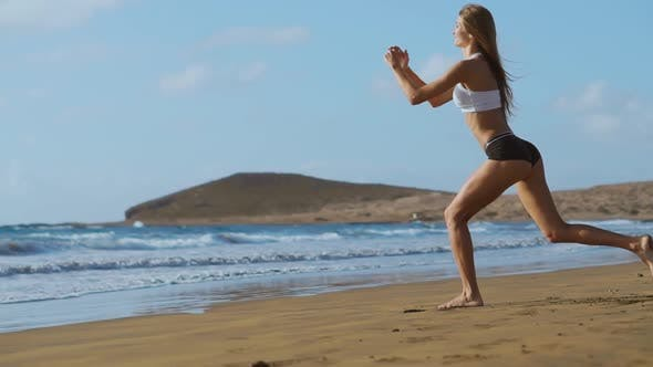 Thumbnail for Sport Girl on a Beach Doing Lunges Exercises. Concept of of a Healthy Lifestyle