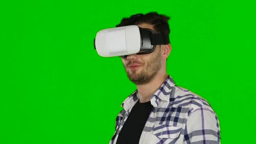 Virtual Reality Game. Girl with Pleasure Uses Head-mounted Display. Green Scree. Close Up