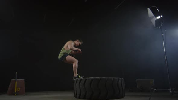 Thumbnail for Sportsman Jumping upon Large Tractor Tire