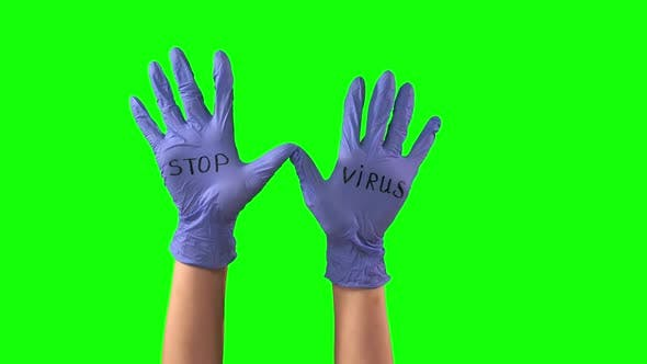 Thumbnail for Words STOP VIRUS at Hands with Medical Blue Gloves, COVID-19 Concept. Close Up Motion.