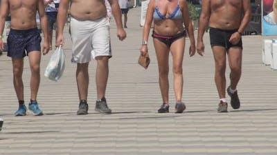 Walking Shirtless on a Boardwalk