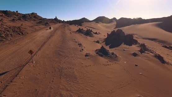 Thumbnail for Lone Car Drives the Desert Road Crossing the Moon Valley. The Landmark of Atacama Desert. Chile