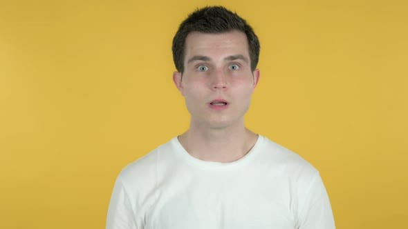 Thumbnail for Shocked Man Feeling Surprised, Yellow Background