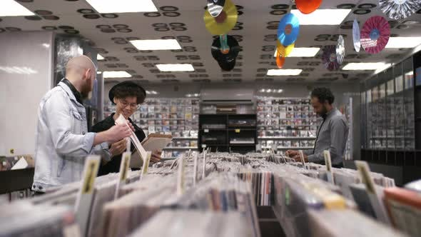 Thumbnail for Caucasian Woman with Hipster Boyfriend Choosing Vinyls in Record Shop