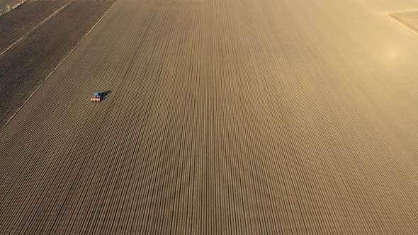 Thumbnail for Tractor Working on Brown Flat Field