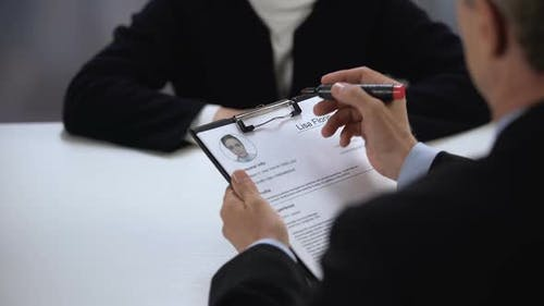 Hiring Manager Marking Female Candidate Resume and Shaking Hands, Hiring