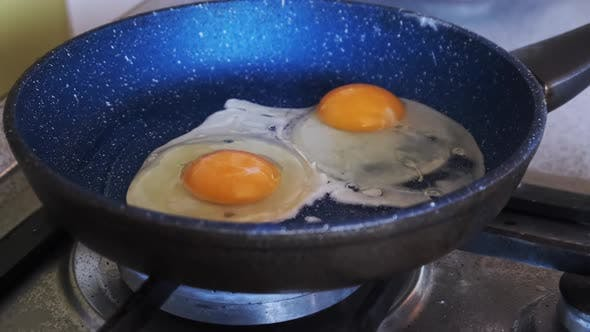 Home Breakfast. Fried Eggs Are Cooked in a Pan in the Home Kitchen