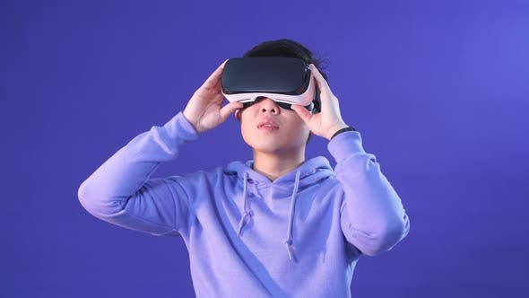 Thumbnail for Korean Young Man Surprised By Something in Virtual Reality