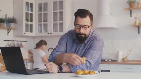 Thumbnail for Man Working on His Laptop in the Kitchen