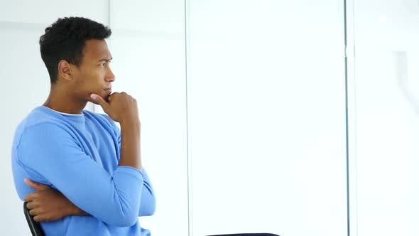 Thumbnail for Pensive Afro-American Man Looking through Office Window