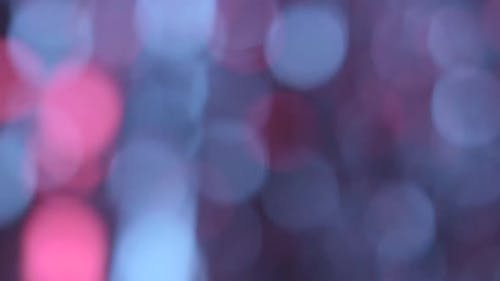 Moving Particles Colorful Blurred Bokeh Lights Background