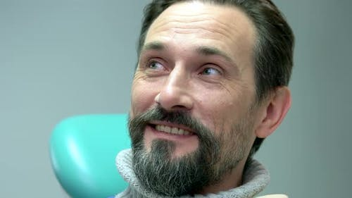 Man at the Dentist Smiling.