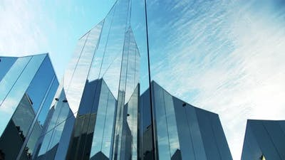 Clouds Reflected in the Glass Surfaces of Modern Structure with Reflective Mirror Surfaces