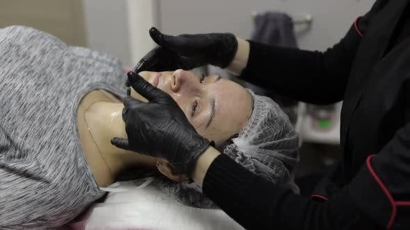 Thumbnail for Cosmetologist Applies Moisturizing Cream on Woman Face in Beauty Clinic Salon