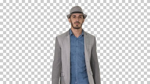 Casual Arabian Man Walking in A Hat and With a Briefcase Alpha